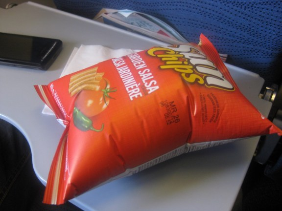 Flying brings other gifts as well, like creating a pillow out of your bag of chips